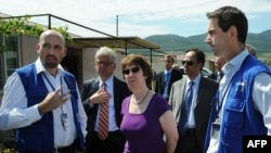 EU foreign-affairs chief Catherine Ashton (center) speaks with members of the EU monitoring mission near the Georgia-South Ossetia border zone in Tserovani earlier this month.