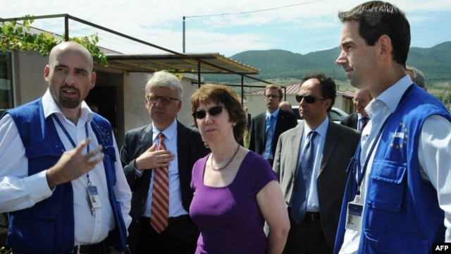 EU foreign-policy chief Catherine Ashton (center) speaks with EU monitors of the Georgia-South Ossetia border zone in July 2010, where Russia reneged on agreements it had made.