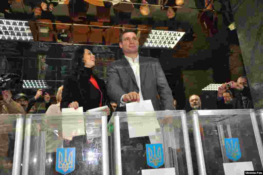 Udar party leader Vitali Klitschko, who is still a reigning world heavyweight champion, votes at a Kyiv polling station.