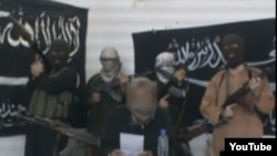 A screen grab from a video posted on YouTube by a group calling itself Jund al-Khilafah (Soldiers of the Caliphate), which has issued threats to the Kazakh government.
