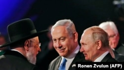 Президент России Владимир Путин на Всемирном форуме по Холокосту