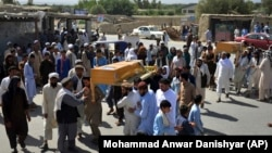 Men carry the coffin of a relative who died during a raid on a house in the Chaparhar district of Nangarhar Province on May 29.