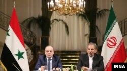 اسحاق جهانگیری (راست) معاون رییسجمهوری ایران همراه با عماد خمیس نخستوزیر سوریه در یک نشست خبری.