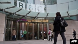 U.K. - BBC employees arrive for work at the organisation's New Broadcasting House in central London, 12Nov2012