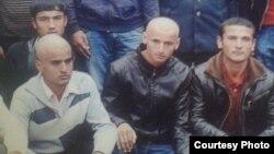 Рамазон Забиров в первом ряду в середине