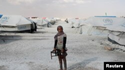 Tinejdžerka u izbjegličkom kampu, Sirija, 2017.