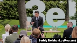 Ukrainian President Volodymyr Zelenskiy gestures during an open-air news conference in Kyiv on May 20.