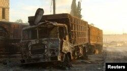 سوریا: دا د لوېدیز حلب ښار ته پروت د یاغیانو تر ولکې لاندې په ارم ال کوبرا ښارګوټي کې د هغه وران ټرک تصویر دی چې په هوايي برید کې ویجاړ شوی دی. ۲۰ سېپټېمبر ۲۰۱۶