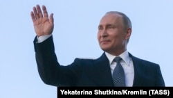 Russian President Vladimir Putin waves to the public after his fourth inauguration as president on May 7.
