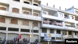 Демонстранты в сирийском городе Банияс