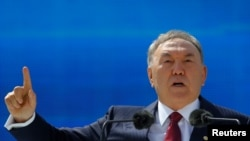 Kazakh President Nursultan Nazarbaev speaks as he attends celebrations on May 1 to mark Kazakhstan People's Unity Day in Almaty, an event that was marked by several protests despite bans on unsanctioned rallies.