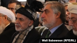 Afghan President Ashraf Ghani (left) and Afghan Chief Executive Abdullah Abdullah have implored lawmakers to let the government work.