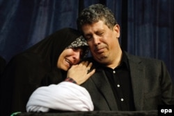 The daughter and son of former Iranian President Ali Akbar Hashemi Rafsanjani grieve beside their father's coffin during a mourning ceremony at the Jamaran mosque in Tehran on January 8, 2017.