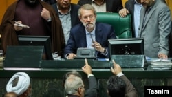 Speaker of Parliament, Ali Larijani, in the impeachment of Iran's labor, Ali Rabiei, 2018.