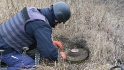 A demining specialist at work earlier this week near the front lines in eastern Ukraine
