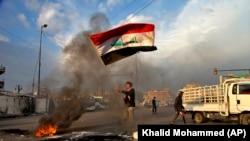 فعالان عرب نزدیک به هشام الهاشمی از او به عنوان فعال اصلاحطلب نام بردهاند که در اعتراضات اخیر مردم عراق همراه با آنان بود (عکس از آرشیو)