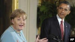 German Chancellor Angela Merkel answers questions during a joint news conference with U.S. President Barack Obama after talks at the White House on June 7.