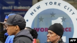 People wait to apply for jobs outside the Department of Labor in the Bronx, New York, earlier this year.