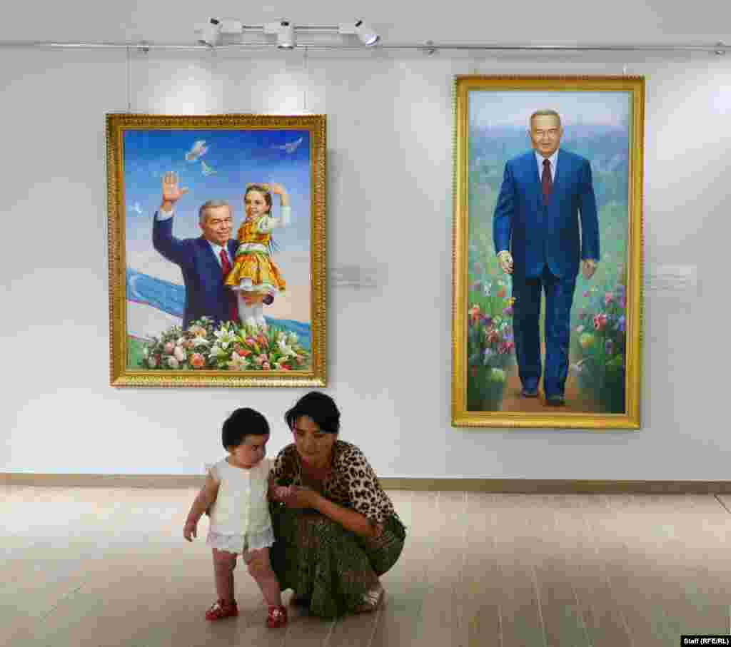 Visitors inside the gallery. A worker at the museum told RFE/RL that most of the paintings were taken from Karimov's own walls, while others were commissioned for the exhibition.