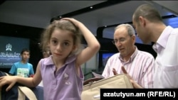 A young Armenian girl from Aleppo arrives at Yerevan airport with her family on July 25.