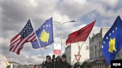 Kosovar Albanians celebrate the first anniversary of Kosovo's independence in Pristina.