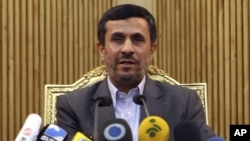 Iran President Mahmud Ahmadinejad briefed the media before departing Tehran's airport for Tajikistan on September 4.
