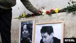A memorial for murdered lawyer Stanislav Markelov and journalist Anastasia Baburova in Moscow