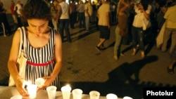 Armenia - A candlelight vigil outside the Harsnakar restaurant in Yerevan, 7Aug2012.
