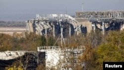 The damaged main terminal of the Donetsk Sergei Prokofiev International Airport is pictured during fighting between pro-Russian rebels and Ukrainian government forces in Donetsk on October 4.