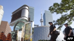 Police patrol the streets ahead of the G20 summit in downtown Toronto.