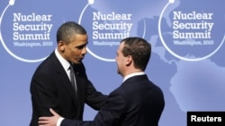 U.S. President Barack Obama (left) greets his Russian counterpart Dmitry Medvedev at the Nuclear Security Summit in Washington on April 12.