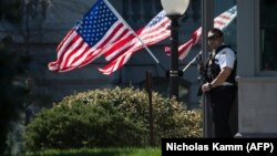 A U.S. Secret Service agent stands guard at the White House, which went into lockdown after a shooting incident on March 28.