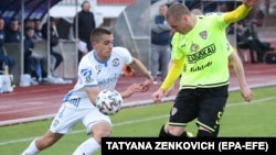Players in action during the Belarusian Premier League soccer match between FC Dynamo-Brest and FC Shakhter Soligorsk in Brest on April 25