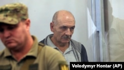 MH17 suspect Volodymyr Tsemakh sits in a courtroom in Kyiv on September 5.