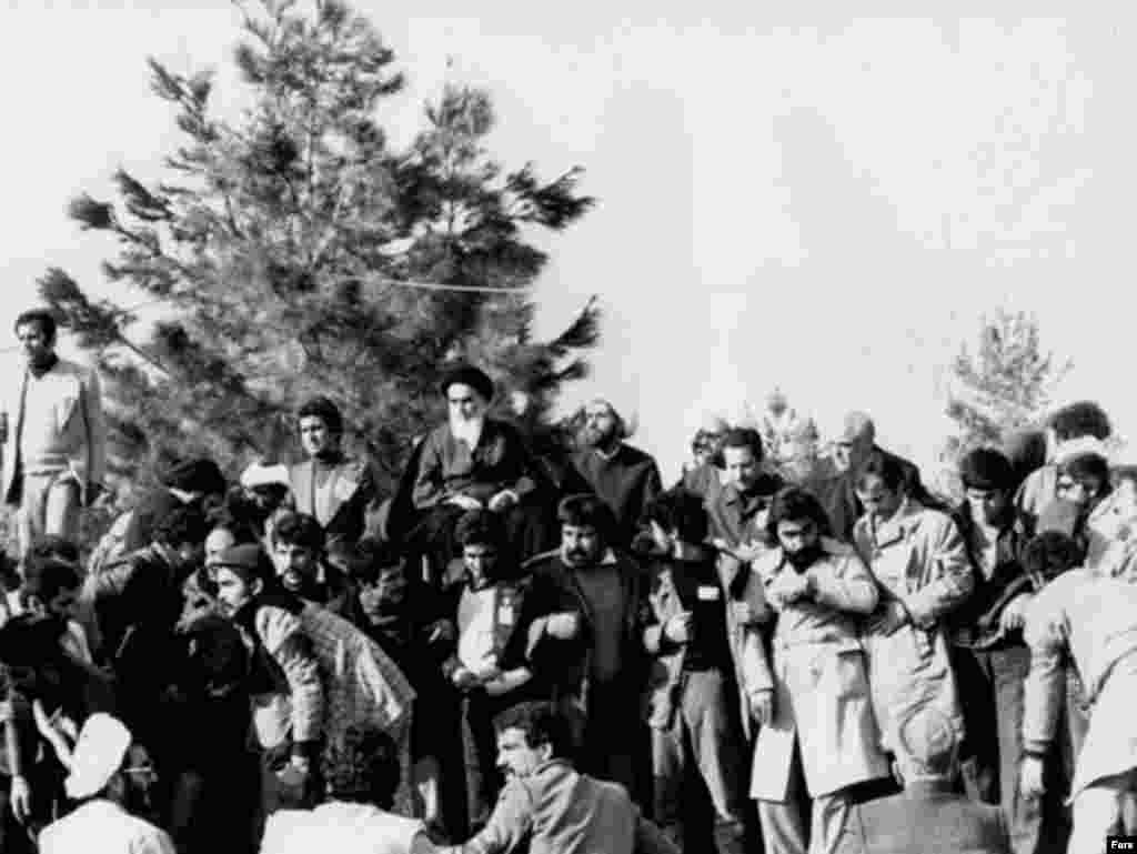 Khomeini gives his first speech at the Behesht Zahra cemetery after his return on February 1, 1979.