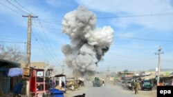 Smoke billows from the scene of a suicide bomb blast that targeted a police headquarters in Kunduz, on February 10.