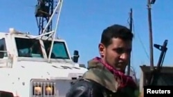 Припадник на сириските бунтовници