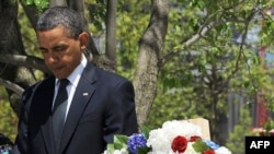 U.S. President Barack Obama bows his head after laying a wreath at the 9/11 Memorial in New York.