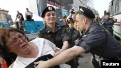 Police detain an opposition protester during a rally in Moscow on May 31.