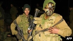 تانک ها و سربازان اسرائيلی شهر غزه را به محاصره خود درآورده اند. (عکس: AFP)