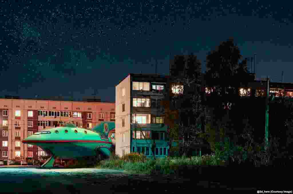 Planet Express Ship, from the Simpsons spin-off Futurama, parked between Soviet-era apartment blocks.