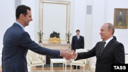 Ресей президенті Владимир Путиннің Сирия президенті Башар Асадты қабылдаған сәті. Мәскеу, 21 қазан 2015 жыл.