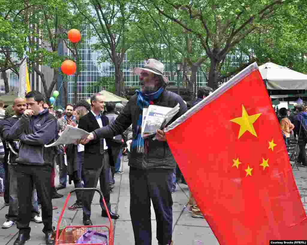 "An OWS protester shouted ""Long live the People's Republic of China,"" while handing out a local daily Chinese newspaper and extolling the virtues of communism."