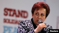 Poland -- Nobel Peace prize laurate Shirin Ebadi of Iran speaks during a session of the 13th World Summit of Nobel Peace Prize Laureates at the Palace of Culture in Warsaw, October 21, 2013