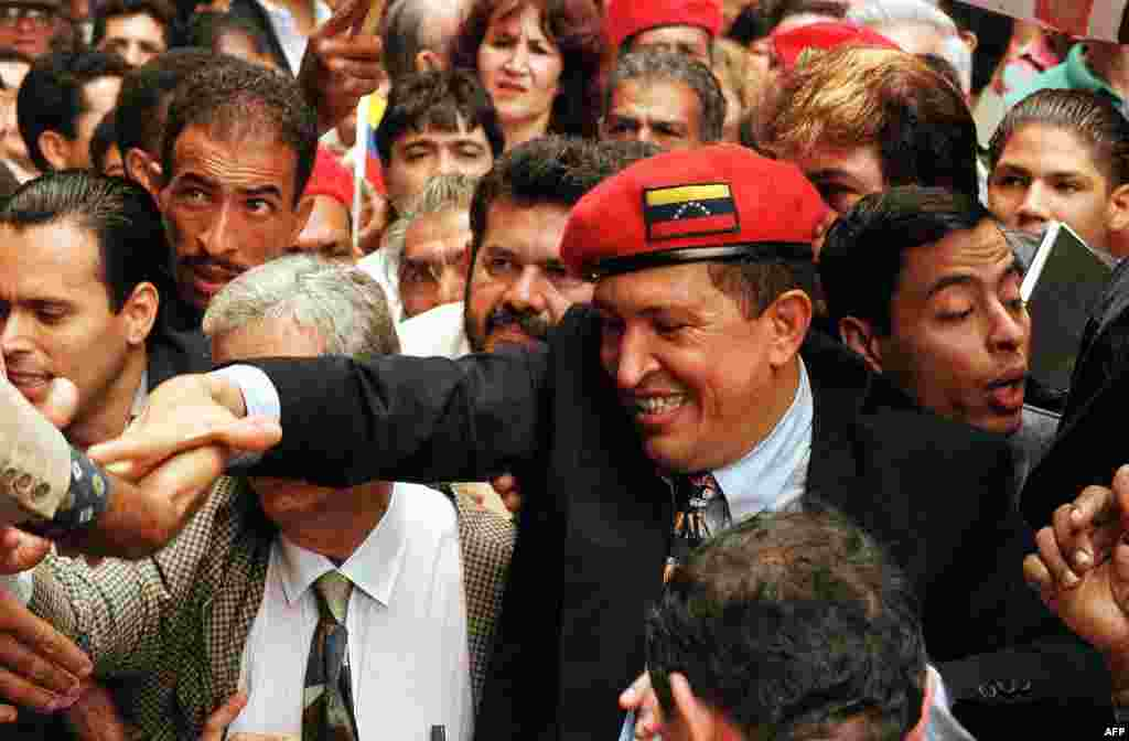 Retired Lieutenant Colonel Hugo Chavez, who led a coup attempt in February 1992, is greeted by supporters in Caracas in July 1997.