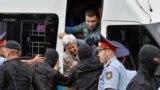 Kazakhstan - Police officers detain opposition supporters during a protest against presidential election, in Almaty, Kazakhstan, June 9, 2019. REUTERS/Mariya Gordeyeva