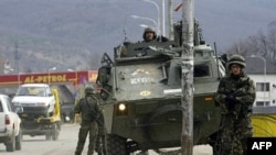 Spanish KFOR soldiers secure a bridge in Mitrovica