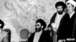 An undated photo probably from early1980s, showing Ali Khamenei (C) and Hashemi Rafsanjani (far R)