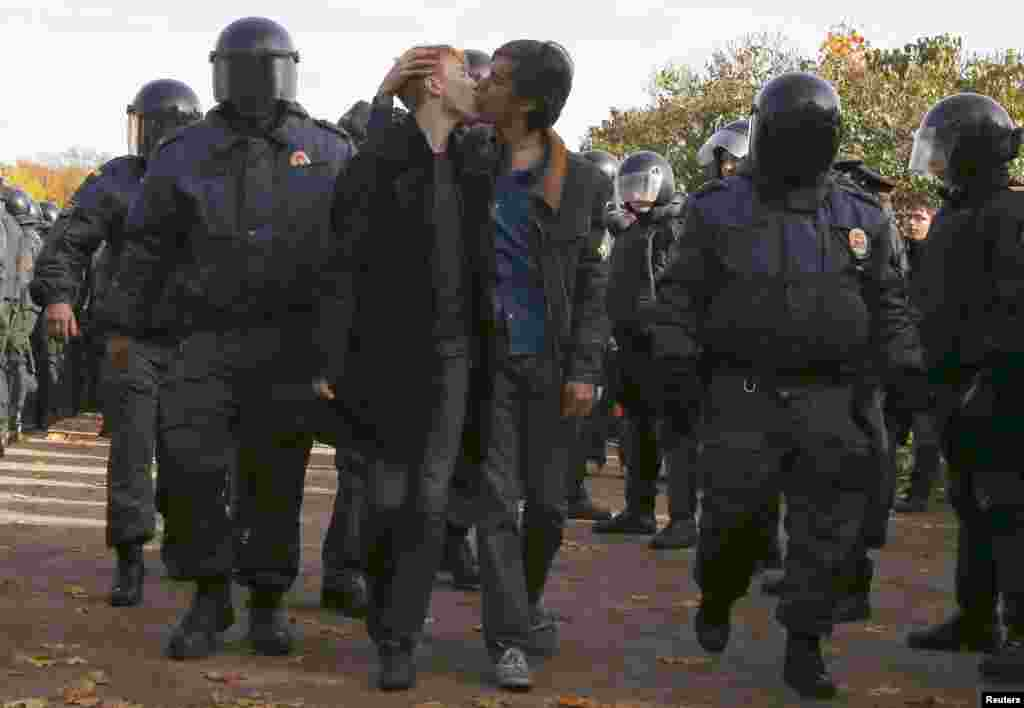 Gay rights activists kiss after being detained by police during a gay rights protest in St. Petersburg. (Reuters/Alexander Demianchuk)