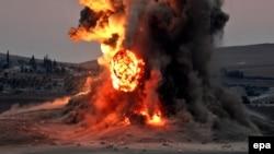 """Удар сил коалиции по позициям боевиков группировки """"Исламское государство"""" в окрестностях сирийского города Кобани (23 октября 2014 года)"""